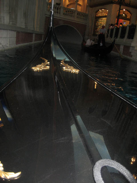 The Venetian – The indoor gondola ride. Yes, we took one! That's my husband and I in the distance. Years ago I visited Venice, Italy, but I missed out on a gondola ride because of the terrible rain. This will have to do until I can return to Venice one day.